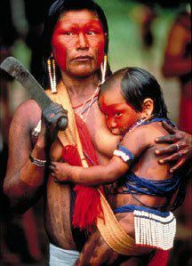 Breastfeeding tribal woman with machete