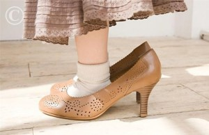 Girl wearing large shoes