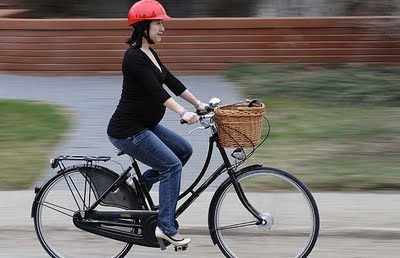 It is unbelievably hard to find a photo of a pregnant woman riding a bike. Hmm I wonder why?